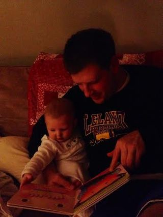 Sasha and daddy reading